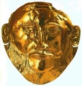 Погребальная маска. 16 век до н. э. Листовое золото; чеканка; гравировка. Национальный музей, Афины. Из гробницы V круга в Микенах.